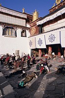 Pilgrims prostrating outside the Jokhang Temple, Lhasa, Tibet, China, Asia