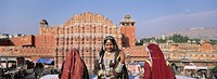 Women in saris in front of the facade of Hawa Mahal Palace of the Winds, Jaipur, Rajasthan state, India, Asia