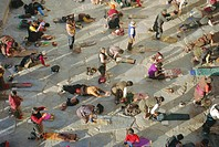Buddhist pilgrims prostrating, Barkhor Jokhang Temple, Lhasa, Tibet, China