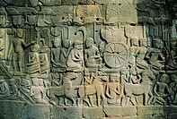 Stone bas_reliefs depicting scenes of rural life and historical events, in the Bayon Temple complex, Angkor, Siem Reap, Cambodia