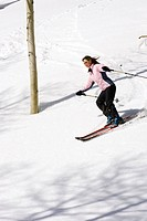 Young woman downhill skiing Dixie National Forest Utah Winter