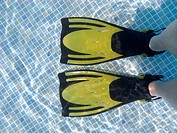 Relaxing in the pool with flippers in the Caribbean