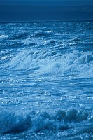 Detail of waves breaking along shoreline @ night Canada