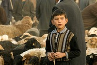 Young Uygur boy at the Livestock Market in Kashgar, Xinjiang Provence, China