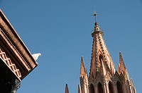 White dove on roof of bandstand in the Jardin Principal with La Parroquia in background, San Miguel de Allende San Miguel, Guanajuato state, Mexico, N...