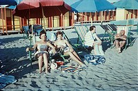 Two young women at beach, Rimini, Emilia_Romagna, Italy