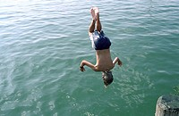 Boy jumping headlong into Water _ Swimming _ Leisure Time _ Youth