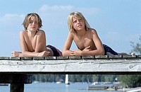 Two Boys bon the Edge of a wooden Footbridge _ Friendship _ Youth _ Summer _ Lake