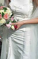 Woman in a Wedding Dress holding a Bunch of Flowers in her Hand _ Symbolism _ Wedding