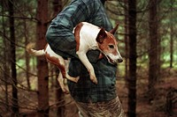 Husse Bär Sin Hund Under Armen, Person Carries Dog Under Arm Amid Trees, Mid Section