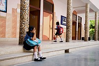 School girl sitting on the steps