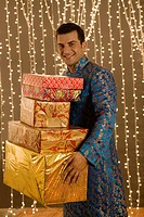 Indian man holding presents