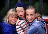 Emma, Julia Och Axel Kramar Varandra. Tre Barn Skrattar Mot Kameran, Woman, Girl And Boy Laughing, Portrait