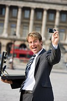 Business man taking picture, Paris, France, Europe