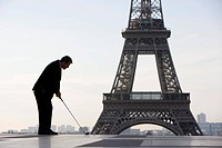 Business man playing golf near the Eiffel Tower, Paris, France, Europe