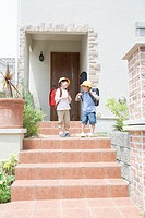 Boy and Girl Leaving Home for School