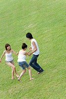 Young people smiling and playing on lawn, Saipan, USA