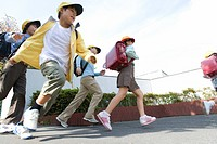 Japanese Students Running On The Street