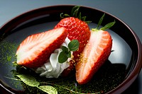 Sliced strawberries on a plate, high angle view, close up, black background, Japan