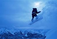 Snowboarder heads down, Paradise area, Mount Rainier, Washington State, United States of America U.S.A., North America