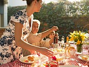 Family at dinner table in garden (thumbnail)