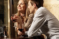 Mid adult couple drinking red wine in restaurant (thumbnail)