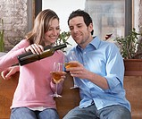Mid_Adult Couple Drinking White Wine