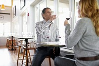 Woman and man tasting red wine