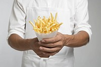 Chef holding french fries mid section