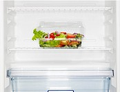 Salad box in fridge (close-up)