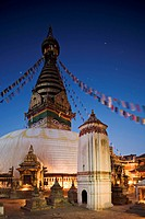 Swayambhunath Swayambhu Monkey Temple Buddhist stupa on a hill overlooking Kathmandu, taken at dawn with Orion in the sky behind the prayer flags, Kat...