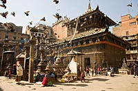 Seto Machendranath temple, close to Durbar Square, Kathmandu, Nepal. Pagoda style gilt roofed temple in a monastic courtyard now housing shops and mar...