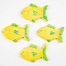 Four fish shaped sugar cookies with decorative icing