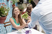 Man giving bunch of flowers to woman (thumbnail)