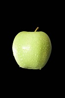Water droplets on green apple