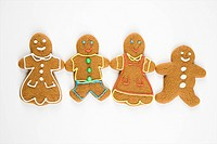 Gingerbread cookies holding hands.
