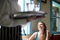 Waiter near female customer (thumbnail)