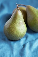 Pears on blue cloth