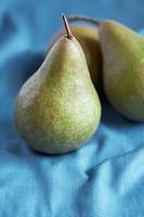 Pears on blue cloth