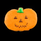 Sugar cookie in shape of pumpkin with decorative icing