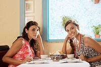 Two women at dining table in restaurant portrait