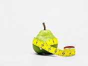 Tape measure around pear