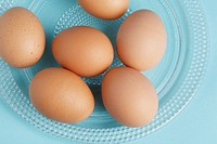 Brown eggs on plate close_up, directly above