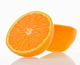 Still life of halved orange against white background