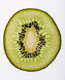 Close up of single kiwi fruit slice on white background