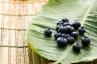 Group of blueberries on banana leaf