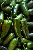 Pile of green jalapeno peppers at produce market