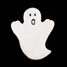 Sugar cookie in shape of a ghost with decorative icing