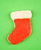 Christmas stocking sugar cookie with decorative icing.