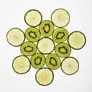 Kiwi and lime fruit slices arranged on white background